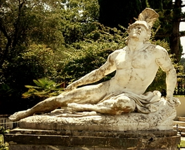 Dying Achilles, the most valuable statue of Achilleion represents Achilles dying trying to remove the spear from his ankle (1884)